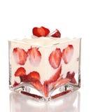 Glass of ripe strawberries with cream Stock Photo