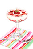 Glass of ripe strawberries with cream Stock Photography