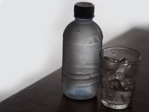 Glass of rock ices and water bottle. Royalty Free Stock Photo