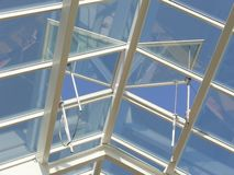 Glass Roof. An overhead glass roof with ventilating windows Stock Image