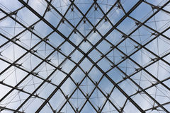 Glass roof. Modern symmetrical transparent glass roof with metal supporting frame Royalty Free Stock Photos