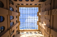 Glass roof. Building of 19th century with a glass roof.Focal length 17 mm stock image
