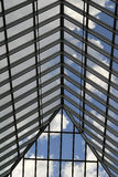 Glass Roof. Blue sky with clouds viewed through glass roof of an atrium Royalty Free Stock Image