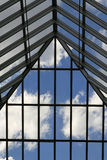 Glass Roof. Blue sky with clouds viewed through glass roof of an atrium Royalty Free Stock Photos