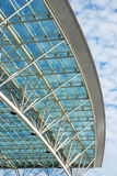 Glass Roof. On modern building set against cloudy sky stock photos