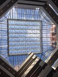 Glass roof with blue sky Royalty Free Stock Image
