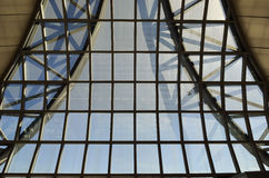 Glass roof on a blue sky Stock Photo