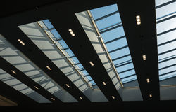 The glass roof of a building against sky.  Royalty Free Stock Photos