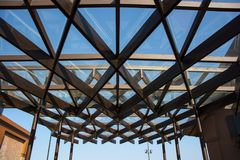 Glass roof of building. With background of clear blue sky., Structure of steel roof frame for building construction on sky background royalty free stock photos