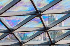 Glass roof of the building with views of the skyscraper through Stock Photography