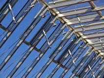 Glass roof construction. Glass roof top construction against a blue sky Stock Image