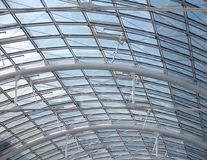 Glass roof detail. Abstract background of a roof construction with glass and metal Stock Image