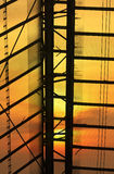 Glass roof detail of Bangkok train station over sunset Royalty Free Stock Photos