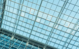 Glass roof of modern office building. With outside blue sky Royalty Free Stock Photos