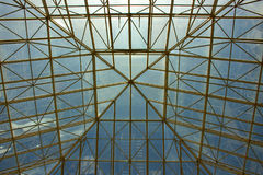 Glass roof. Pyramid construction. Modern architecture. Sky and clouds. Puerto Banús city, Marbella, Andalusia, Spain. Picture taken – 19 july 2017 Royalty Free Stock Photography