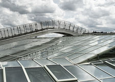 Glass roof stairs. Dramatic cloudy sky above modern glass roof structure with metallic stairs Royalty Free Stock Photos