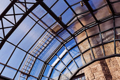 The glass roof of a station in the sunlight Stock Photography