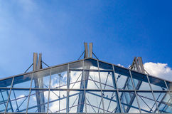 Glass roof, steel structure. Glass roof in a steel structure against a blue sky with clouds Royalty Free Stock Photography