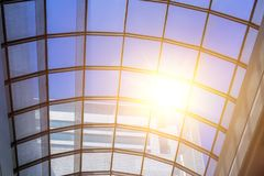 Glass roof with sunny light. Pass through Stock Photos