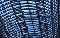 Glass roof top of a big train station in blue shade Royalty Free Stock Photography