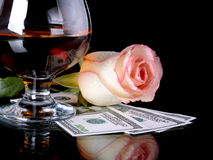 Glass, rose and money. Royalty Free Stock Photo
