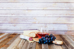 Glass of rose wine with appetizers Stock Image