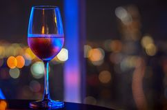 A glass of Rose wine with bokeh light stock photos