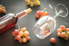 Glass of rose wine with bunch of grape Stock Image