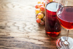 Glass of rose wine with bunch of grape Stock Photography