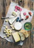 Glass of rose wine, cheese, cured sausage, fig, blueberry, bread Stock Images