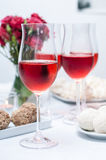 Glass of rose wine in the foreground Stock Image
