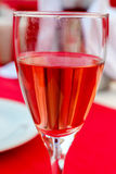 A glass of rose wine Stock Images