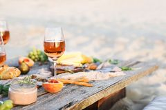 Glass of rose wine on rustic table. Food and drink background royalty free stock image
