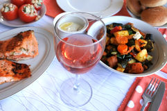 Glass of rose wine served with vegetarian food Stock Images