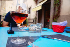 Glass of rose wine on the table Royalty Free Stock Image
