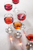 Glass of rose wine. On white table stock photos