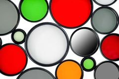 Glass round filters of different colors and sizes royalty free stock photography