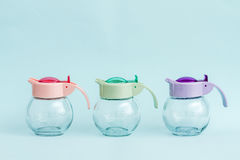 Glass Round Jars with Colorful Handles Royalty Free Stock Image