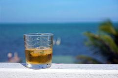 Glass of rum. On the beach royalty free stock photos