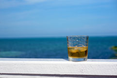 Glass of rum. On the beach stock images