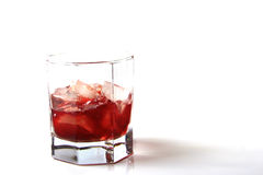 Glass of rum with ice Stock Photo