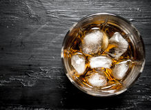 Glass of rum with ice. Stock Images