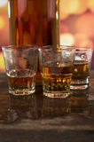 Glass of rum whiskey over defocused lights Stock Photography