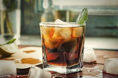 Alcohol, rum, Cuba Libre, cocktail, longdrink, strong drink,. Glass of rum on the wooden background, Cuba Libre or long island iced tea cocktail with strong stock images