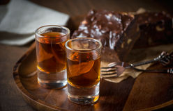 Glass of rum on wooden tray royalty free stock image