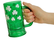Glass of saint patrick. And hand isolated on white background Stock Photos