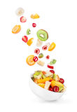 Glass salad bowl in flight with fruit Stock Photography