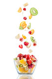 Glass salad bowl in flight with fruit Royalty Free Stock Image