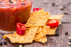 Glass with Salsa Sauce and Nachos Royalty Free Stock Images
