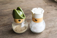 Glass salt and pepper. On wood floors Stock Image